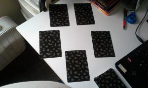 Five card spread in slight circular pattern