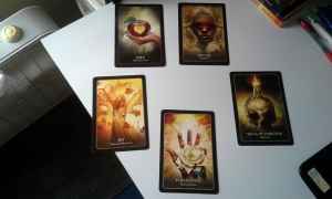 Five card spread, cards turned upside and revealed.