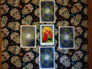 My summer solstice spread before revealing the cards. In the center is the Sun-19 card.