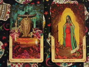 Two Tarot cards. The Hierophant- V and Santa Muerte -XIII (Death), from the Santa Muerte Tarot deck