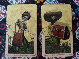 Two Tarot cards. The Page of Pentacles and the King of Pentacles, from the Santa Muerte Tarot deck.