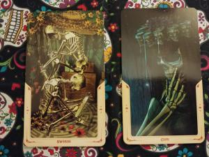 Two Tarot cards: Three of Swords and Eight of Cups, from the Santa Muerte Tarot deck