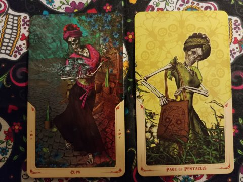 Two Tarot cards: Six of Cups and Page of Pentacles from the Santa Muerte Tarot deck