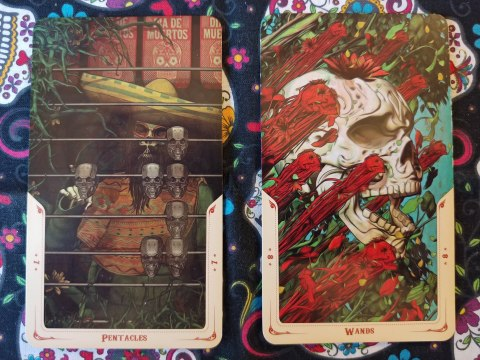 Two Tarot cards. Seven of Pentacles and Eight of Wands from the Santa Muerte Tarot deck