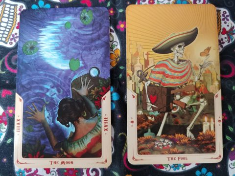 Two Tarot cards: The Moon- XVIII and The Fool-0 from the Santa Muerte Tarot deck
