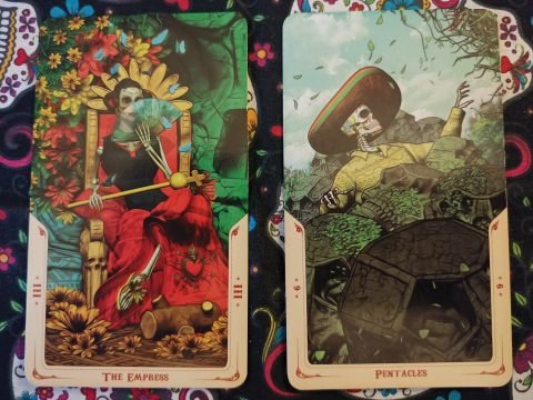 Two Tarot cards. The Empress-III and Nine of Pentacles from the Santa Muerte Tarot deck.