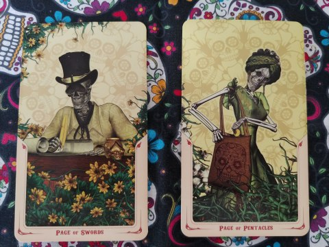 Two Tarot cards. Page of Swords and Page of Pentacles from the Santa Muerte Tarot deck