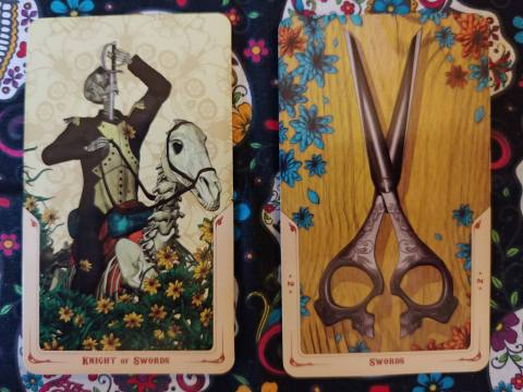 Two Tarot cards. Knight of Swords and Two of Swords from the Santa Muerte Tarot deck