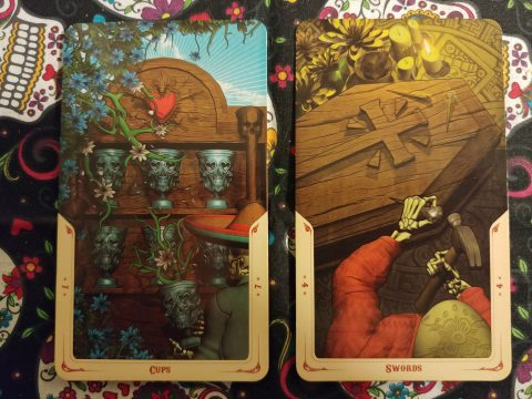 Two Tarot cards: Seven of Cups and Four of Swords from the Santa Muerte Tarot deck.