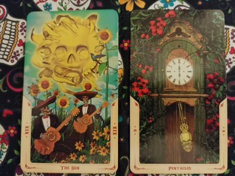 Two Tarot cards: The Sun- XIX and Six of Pentacles from the Santa Muerte Tarot deck.