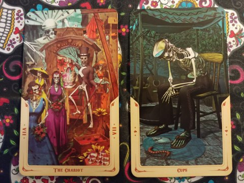 Two Tarot cards: The Chariot-VII and Four of Cups from the Santa Muerte Tarot deck