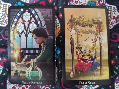 Two Tarot cards: Three of Pentacles and Four of Wands from the Witches Tarot